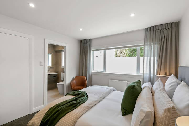 Each bedroom is fitted out with luxe queen beds and a separate reading chair