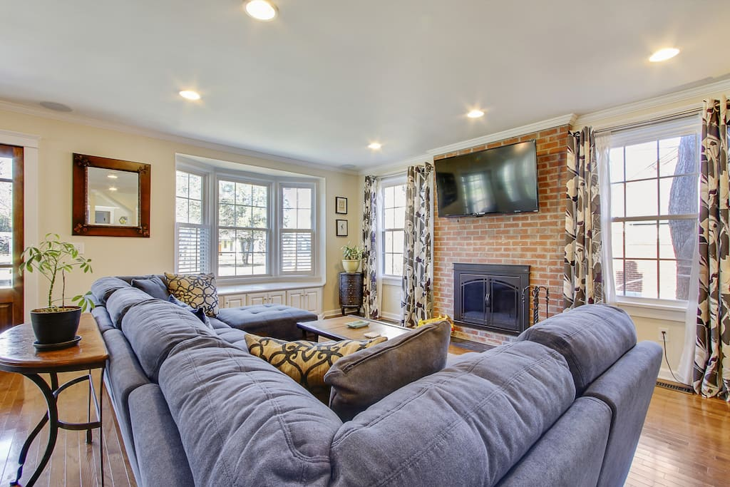 A huge couch faces the TV and fireplace