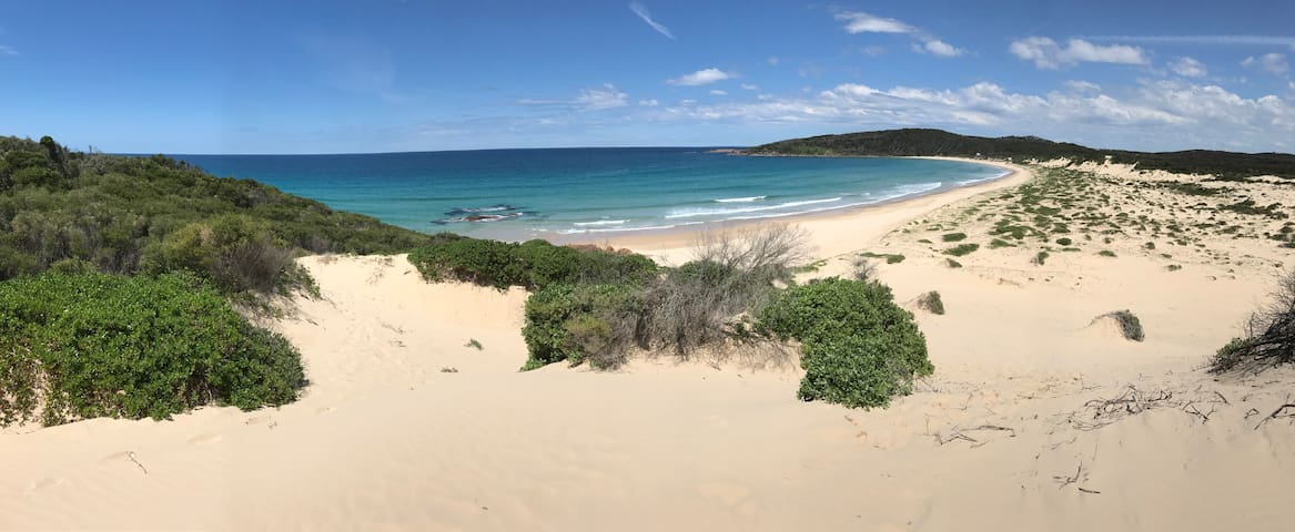 Walk to One Mile Beach and sand dunes