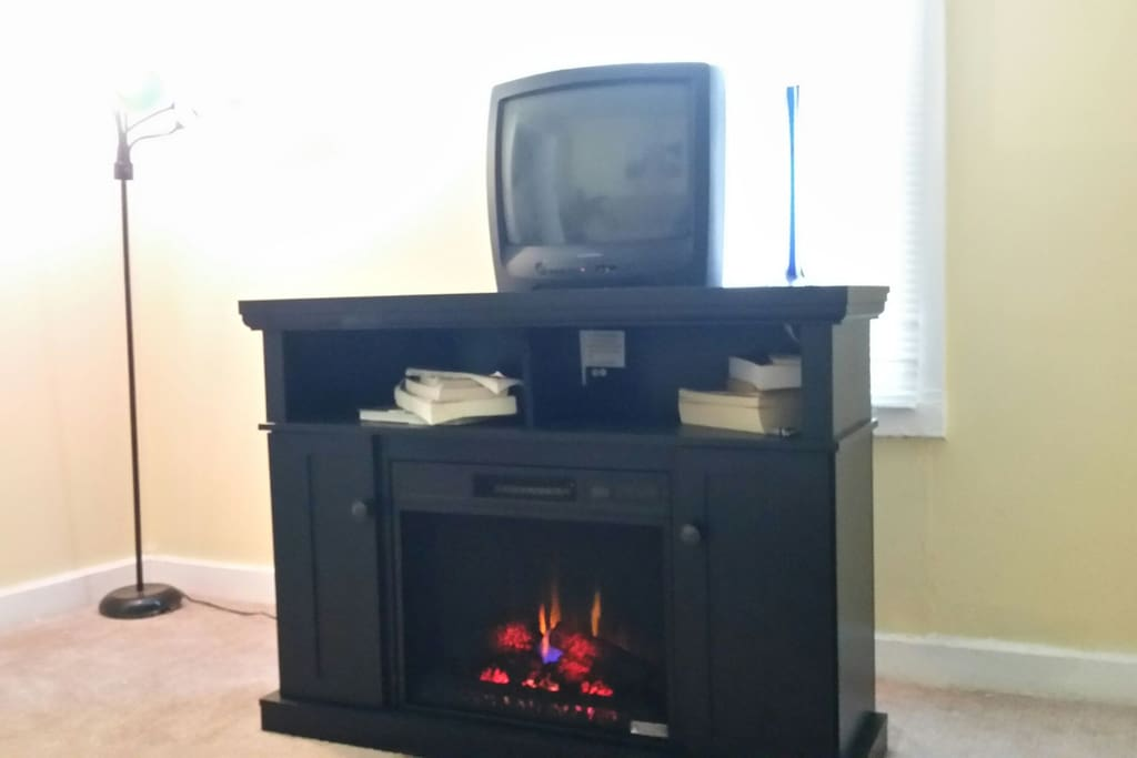 See our upgrades living room for guests.  Room heating electric fireplace.  A great way to relax on your trip.