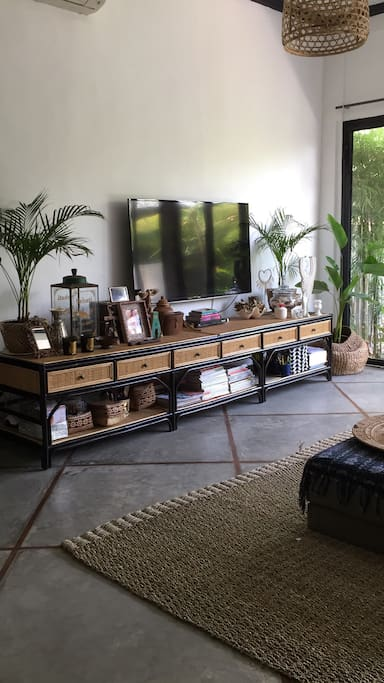 Large enclosed living room with AC and digital TV.