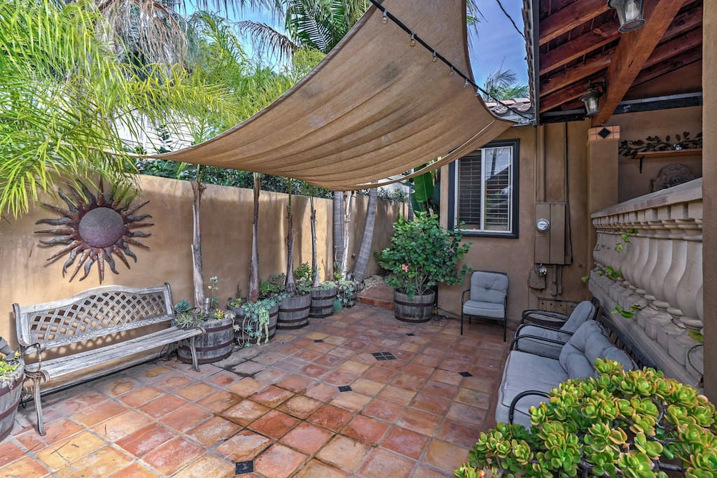 Spend sunny days out on the private patio offering a full outdoor kitchen, ample seating, and a hot tub.