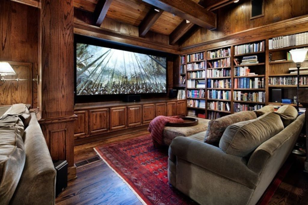 """The private theater room has a 125"""" screen."""