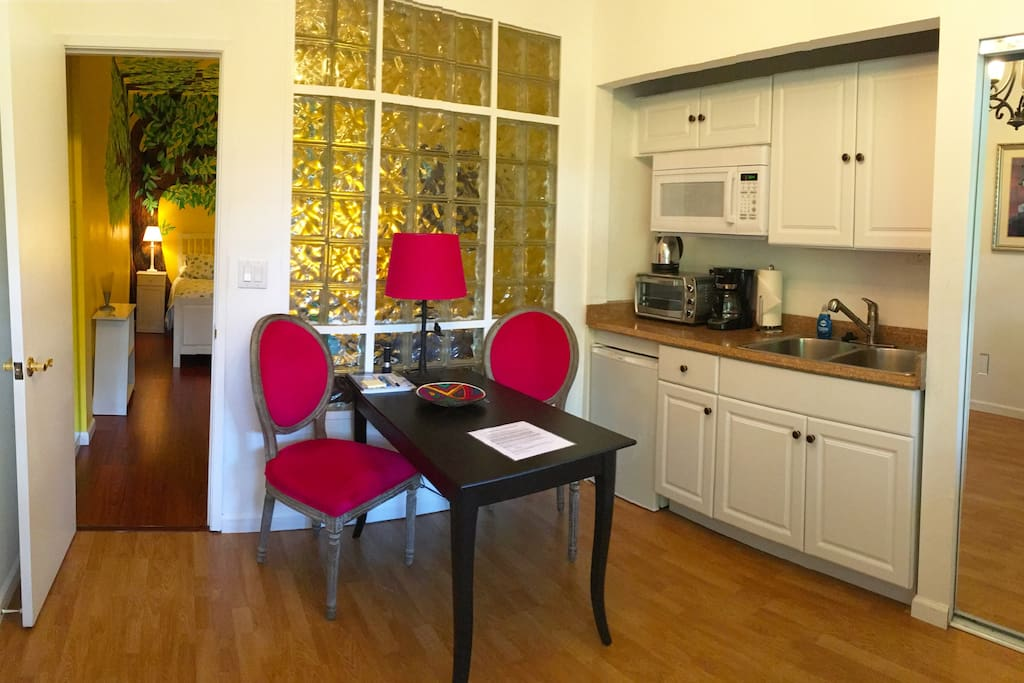 Eat in kitchenette with half fridge, double sink & disposal, microwave, counter-top oven and fully furnished with dishes, pans, crock pot, counter top induction hot plate, etc.