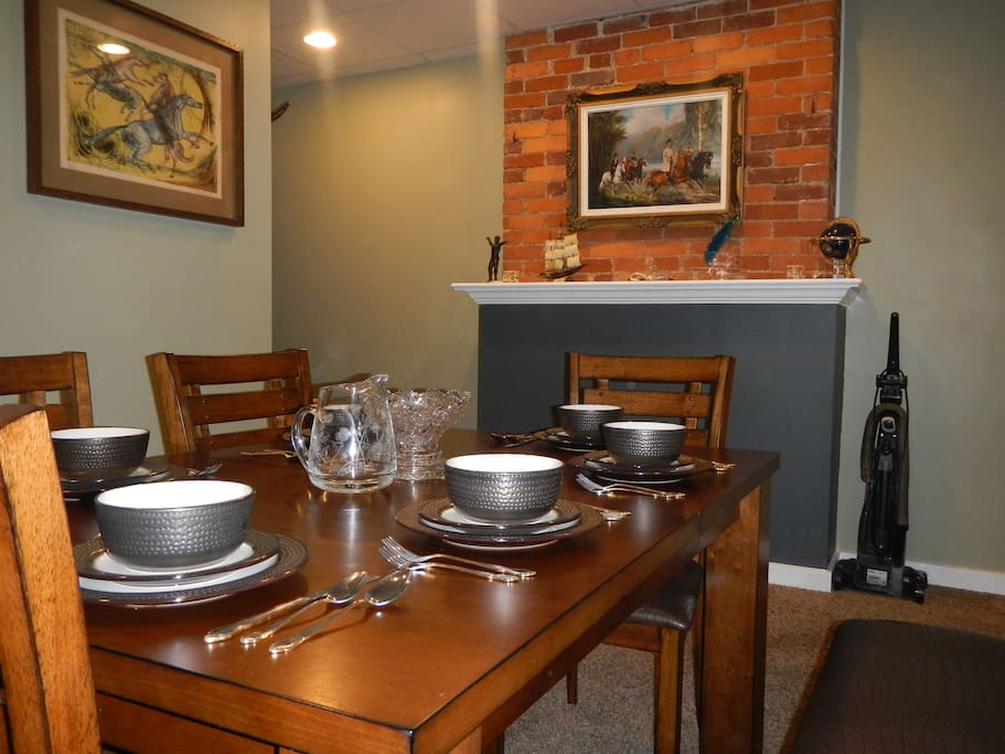Spacious dining area with seating and dinnerware for six enables you to host additional guests to dinner