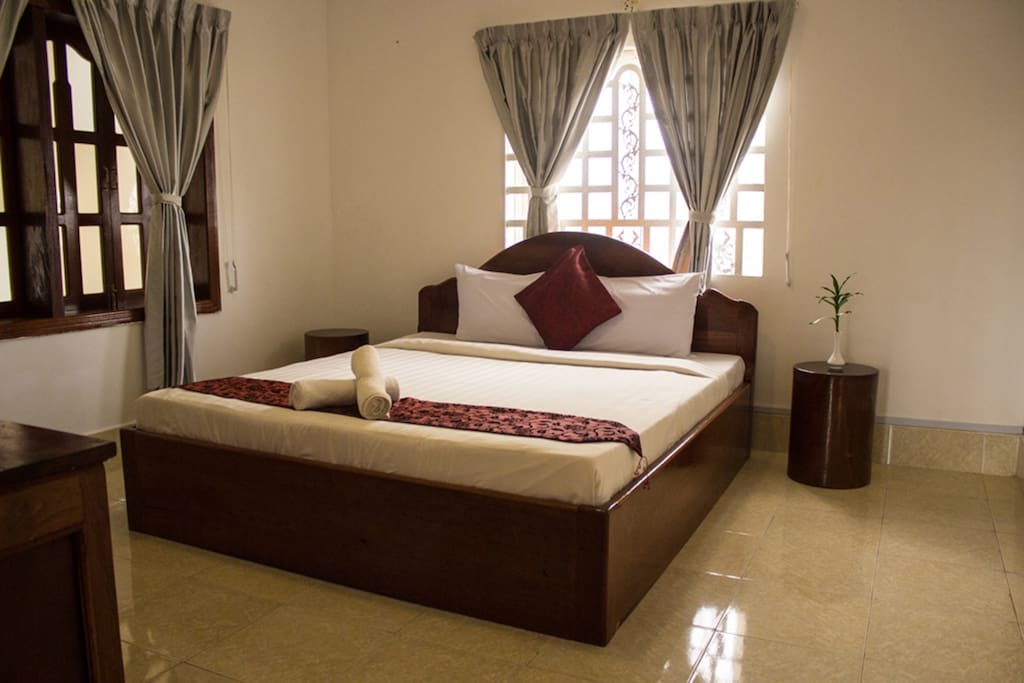 Family Room 1 has a queen bed and windows overlooking the lobby and outside