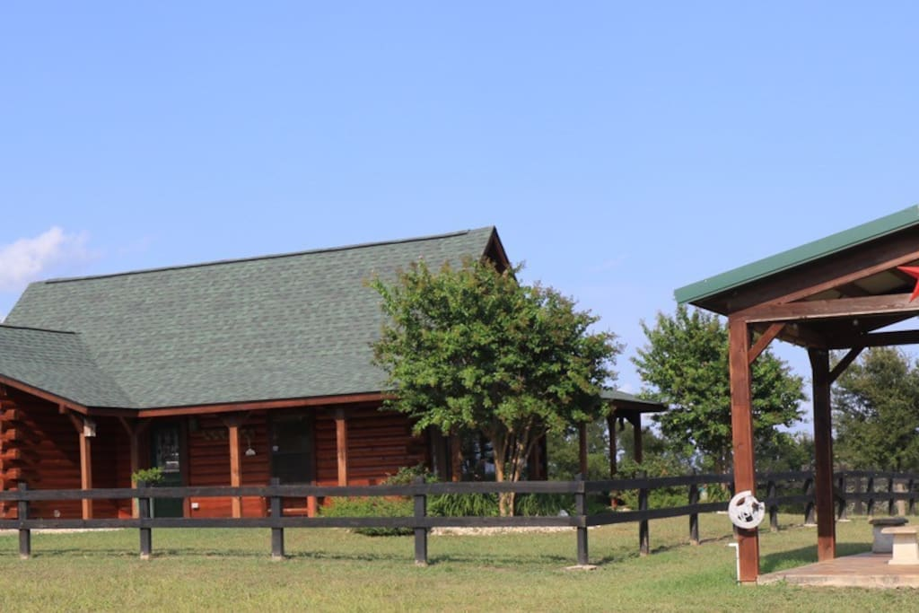 The Log Cabin is located on a gated 47 acre ranch.  You will enjoy panoramic views on 3 porches. There is a large stocked fishing pond for guests.  Bring your own tackle for catch and release fishing.  The cabin is furnished with leather sofas, two bedrooms with comfortable bedding and adjoining baths, a sleeping loft with full futons and a fully equipped upscale kitchen.