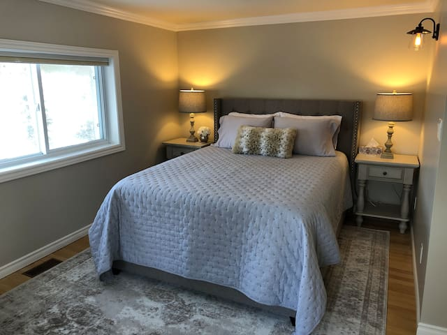 Second floor master bedroom with new queen bed and new plush pillow top mattress.