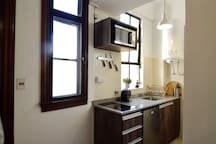 Small but fully equipped kitchen: microwave, small electric oven, vetro-ceramic electric stove, water heater, etc.