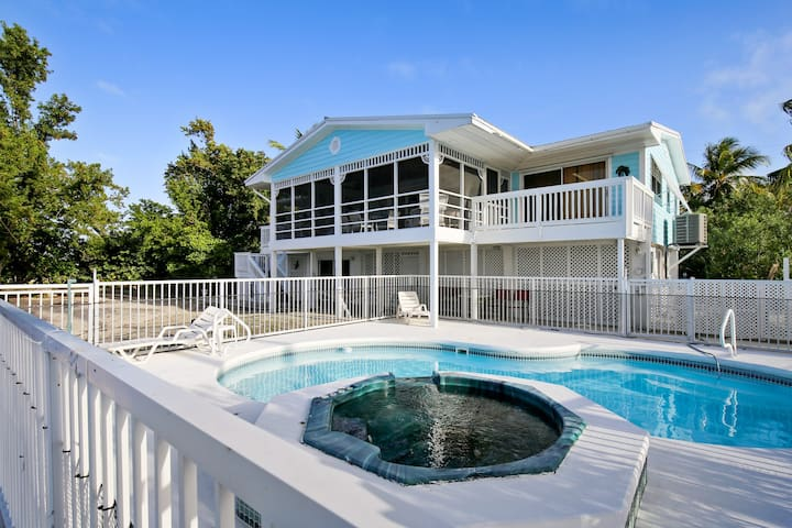 Waterfront home w/ a pool, hot tub, & amazing views of the Gulf of Mexico!