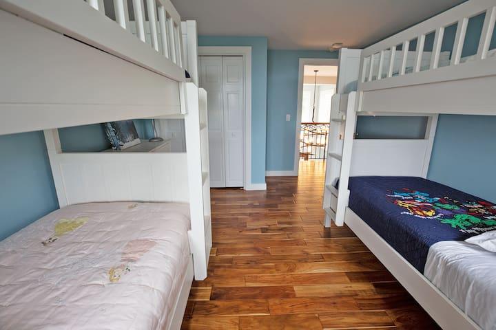 Bunk bedroom. Four singles. Lots of giggling.  SECOND FLOOR