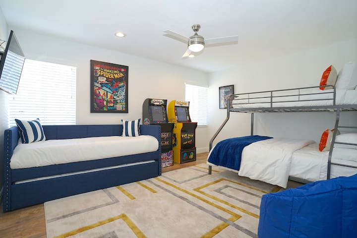 Suite Five Is Simply Spectacular & Features Twin Over Queen Bunk Bed + Trundle Bed (Two Twin Mattresses) + Pac-Man + Galaga Full Size Arcade Games + Samsung 4K Smart Streaming TV + Bean Bag Chairs + Walk-In Closet..