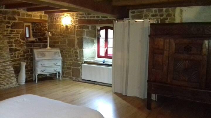 Chambre d'hôte dans manoir ancien.