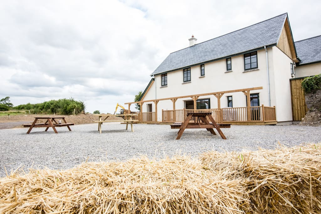 The Lime House (Strawbale Eco-lodge) with additional showers, toilets, kitchen and dining facilities for the Winter season.