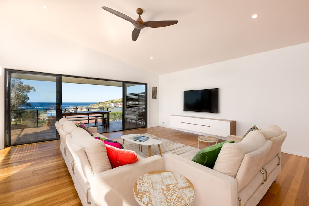 living room opening to deck