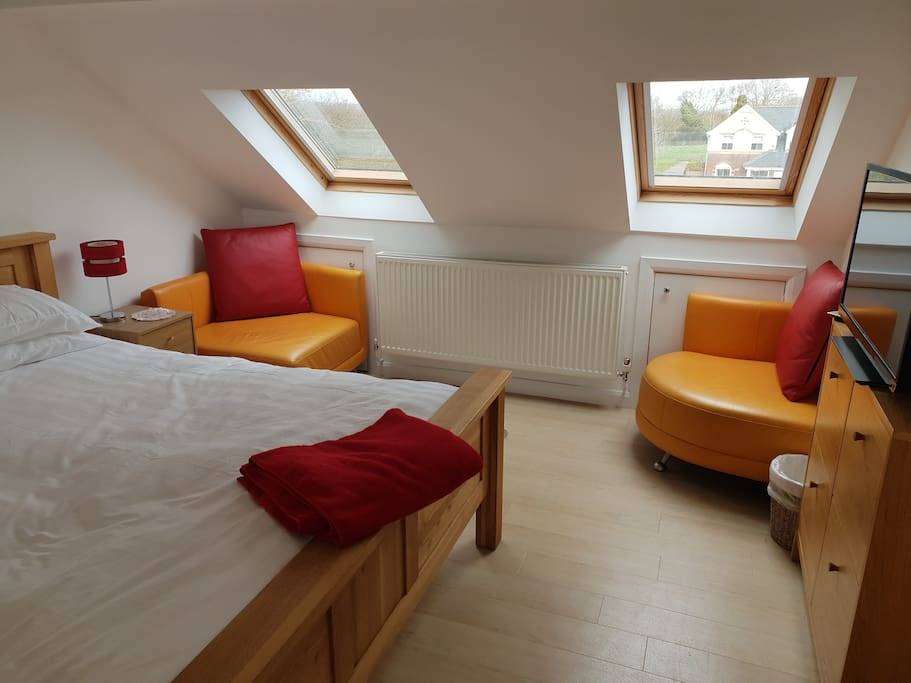 Far side of bedroom past the Super King Size bed, twin electric velux