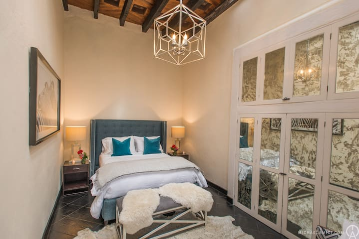 Azul Bedroom with Large Beautiful Antique Mirrored Closets and Adjoining Stunning Full Bathroom.