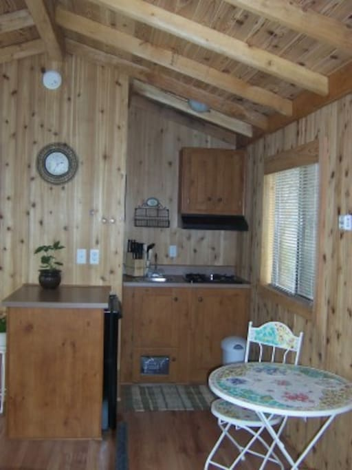 Kitchenette toilet and shower to she left