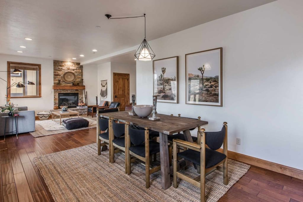 Just off the kitchen is the formal dining room area with dining table and comfortable seating for eight (8) people.