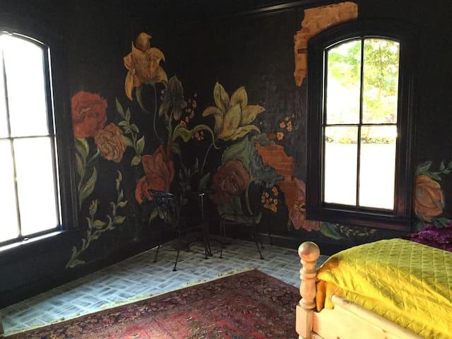 """Mural"" bedroom in Historic 1854 Brick Home"
