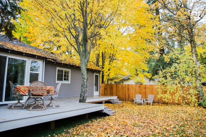 Nice fenced backyard with deck and seating for four