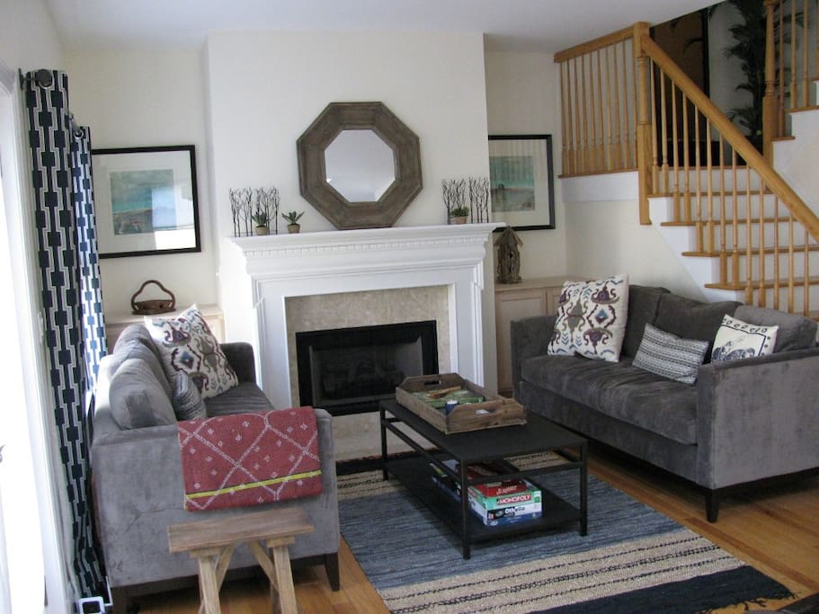 Living room with fireplace, walk out deck area, light and bright!