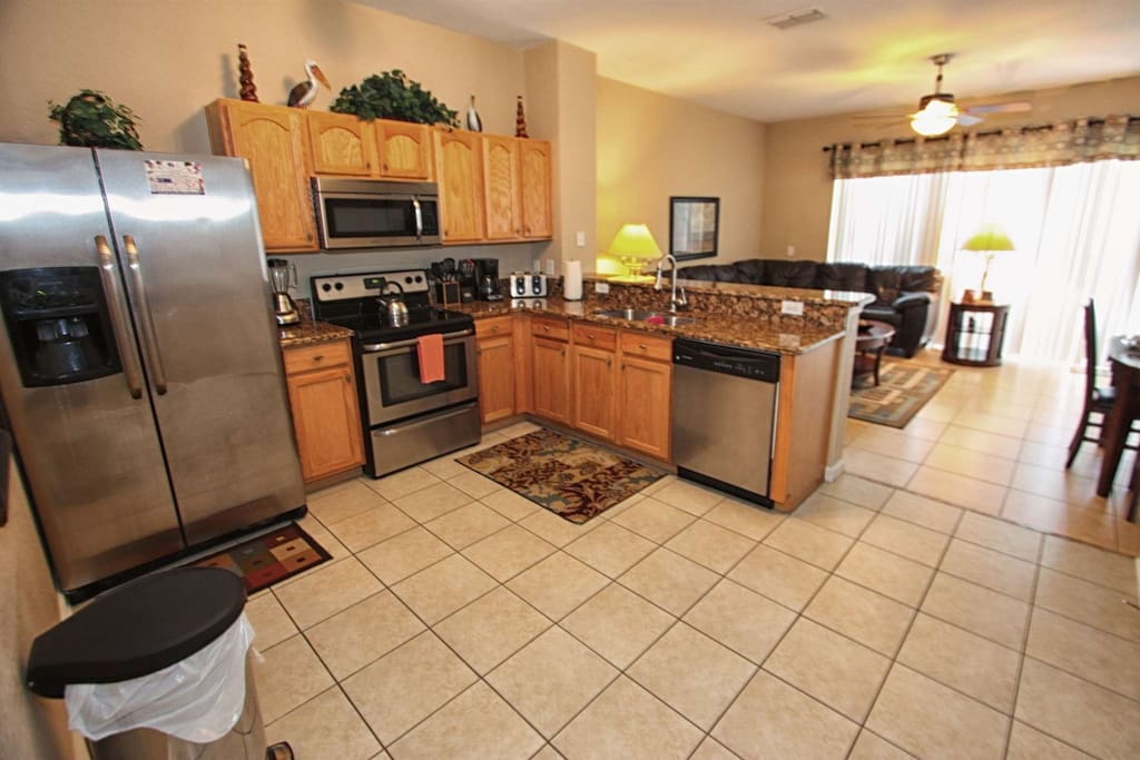 Kitchen w/Granite Counter Tops and Stainless Steel Appliances