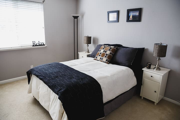 Modern Bedroom with Queen Bed in 2 Story Home