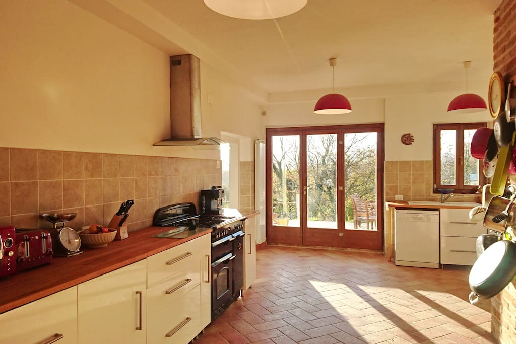 Large, sunny kitchen... Fully equipped with a dishwasher, washing machine, microwave, fridge-freezer, coffee machine and an abundance of pots, pans and crockery  The dining room is the same size and currently being refurbished complete by Jan 18.