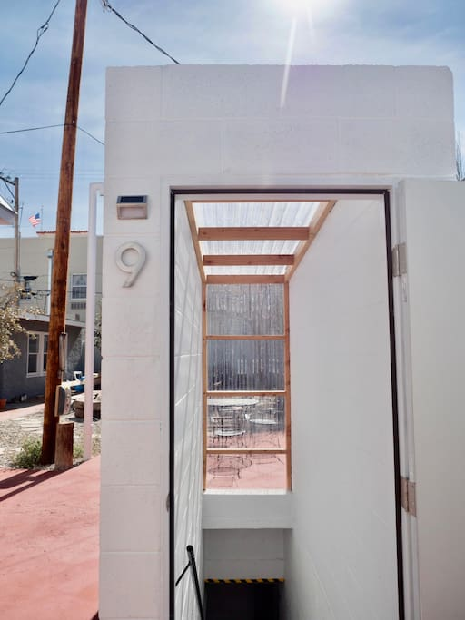 An unassuming entrance through the back courtyard, designed to let the sun shine in.