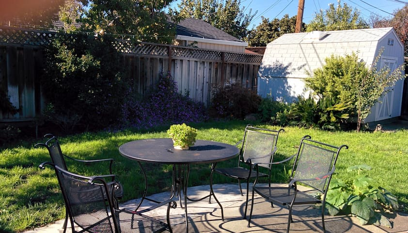 Patio with lawn chairs. Barbecue grill also available