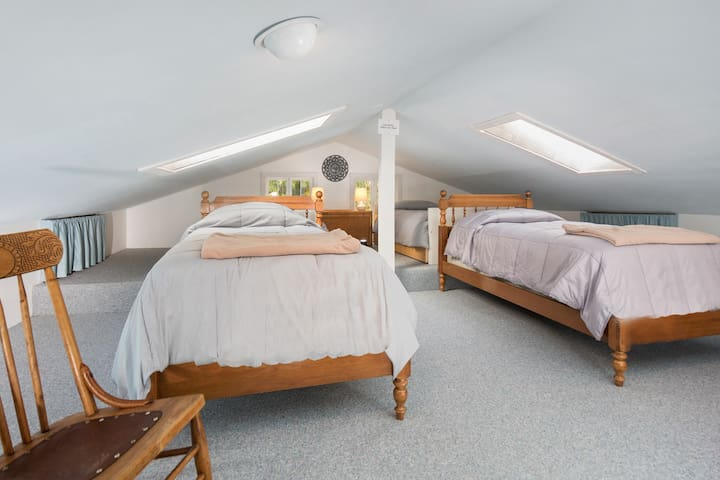 Our upstairs sleeping loft with 4 single beds. Kids LOVE it up here.