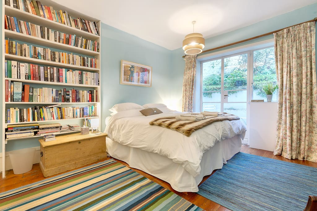 Spacious bedroom with super kingsize bed - and lots of books!