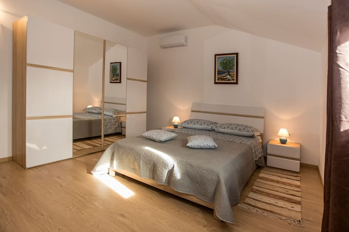 Master Bedroom with the walk-in bathroom and AirCon.