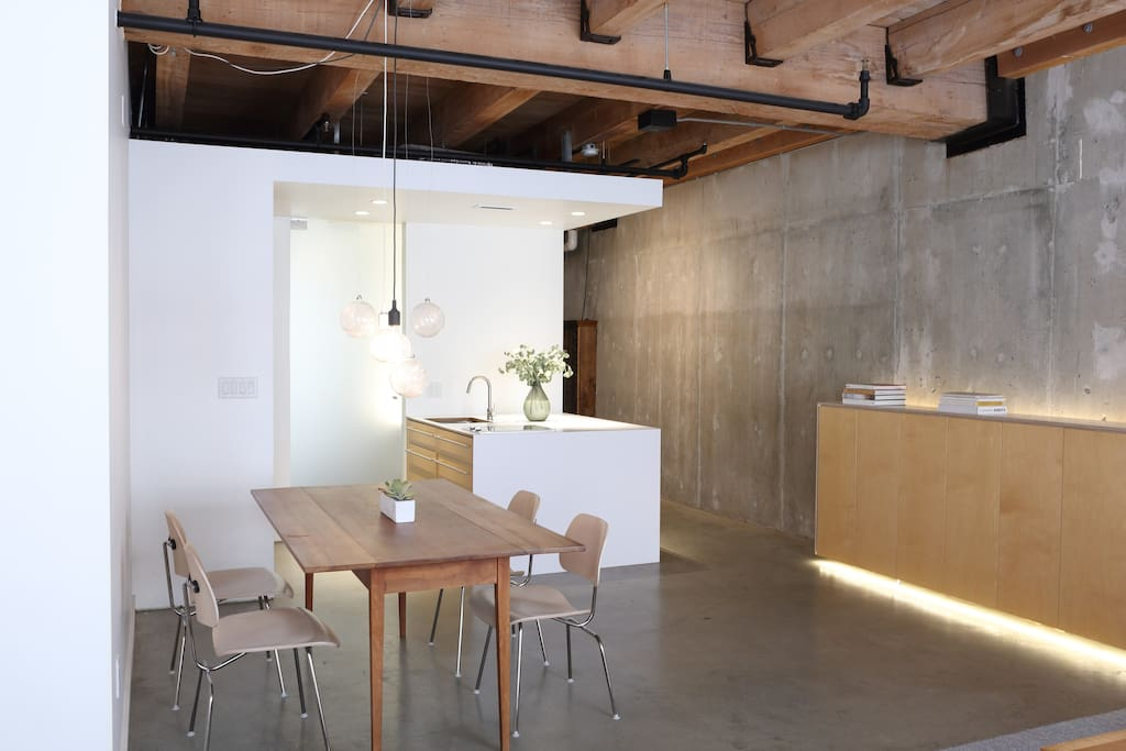 The loft is spacious, bright and full of crisp architectural details.