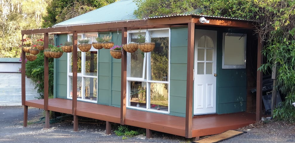 Bluemoor Cottage with lovely verandah large enough to bring the table and chairs out to enjoy the view of the visiting wild life and birds and resident whippets to visit you if you wish.