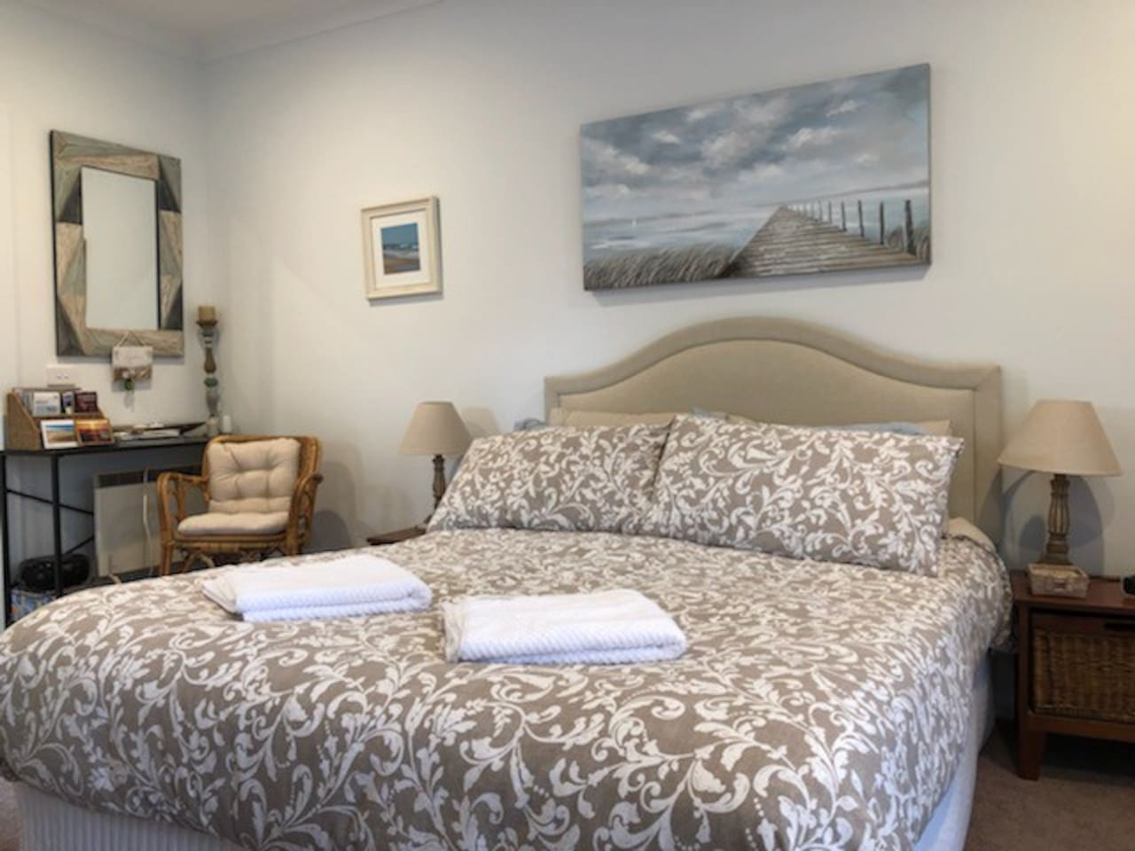 Queen size bed, linen provided, local information and a space heater