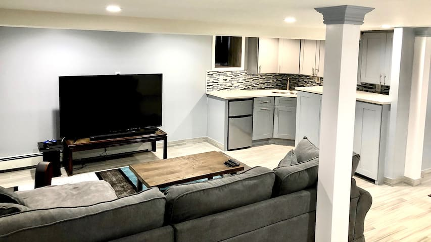 Spacious living space with big screen TV