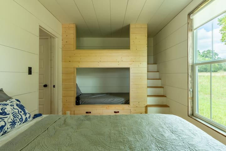 View of the master bedroom with a Queen bed (sleeps 2) and two twin bunk beds (sleeps 1 each).