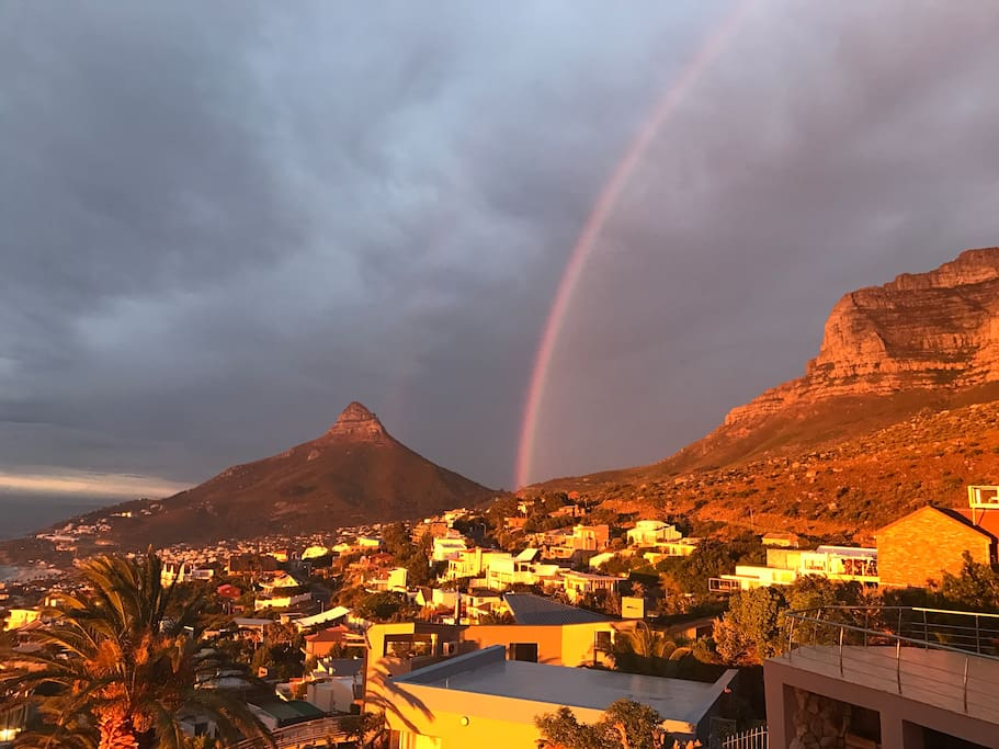 A beautiful rainbow enlites the famous Table Mountain where Bateleurs nestles at the foot of it
