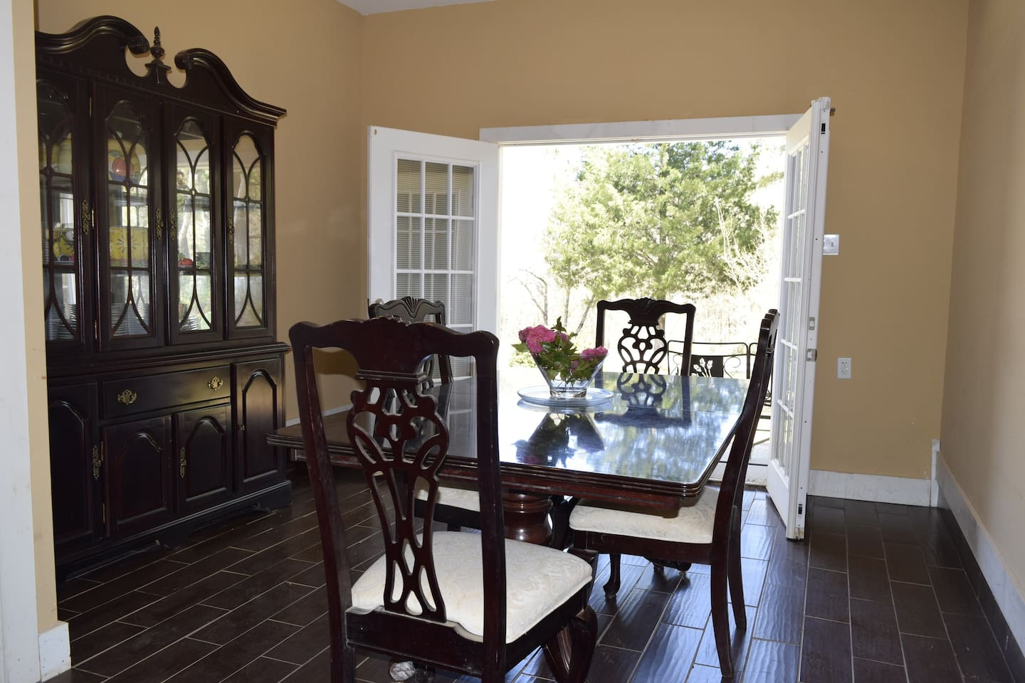 Dining Room with French Doors that open to an outdoor seating area at the front of the house.