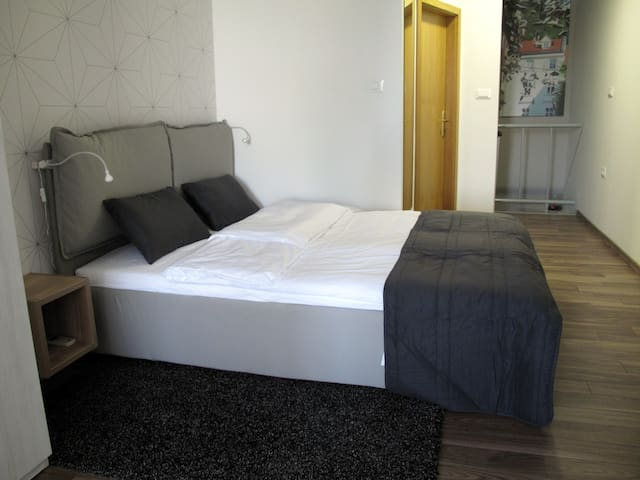 Comfortable double bed in first bedroom