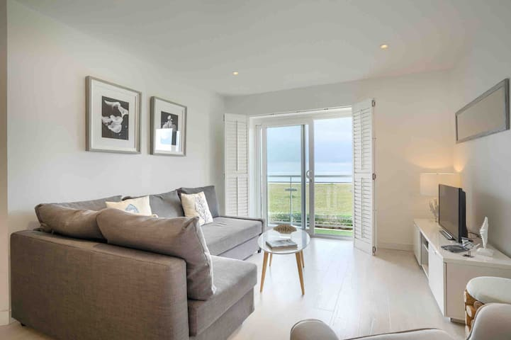 Our beautiful open plan living area overlooking the beach with uninterrupted sea and beach views and access to our terrace