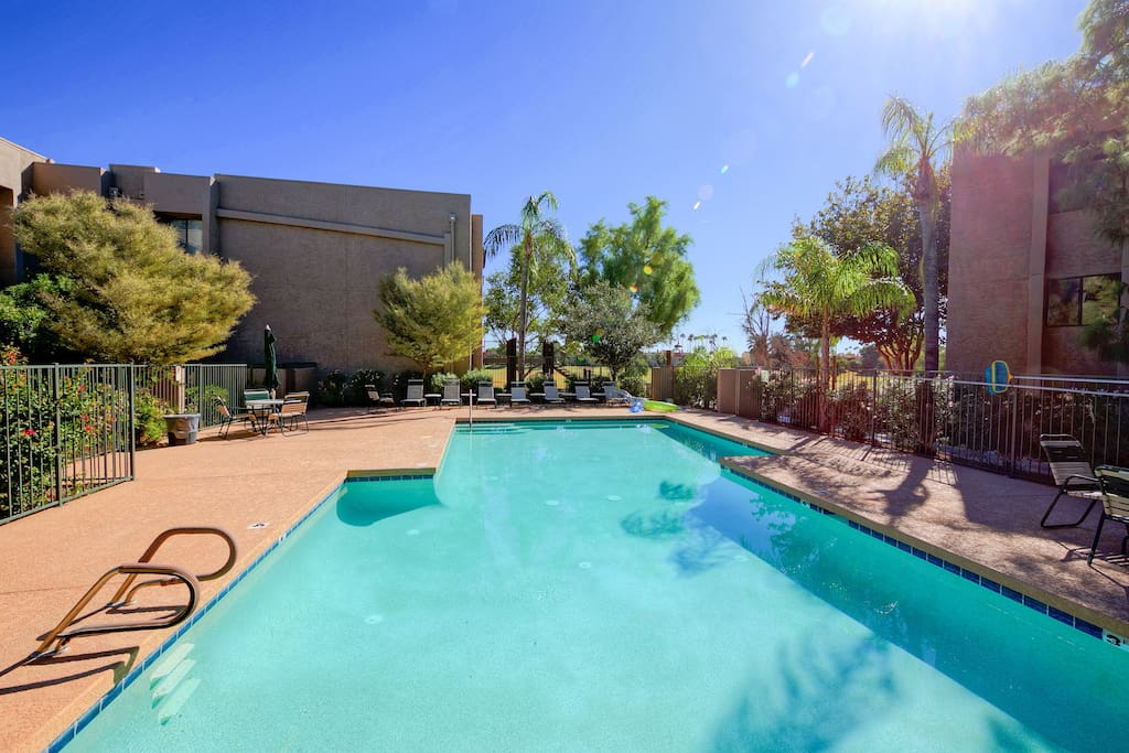 When in Scottsdale, take a dip...where a large community swimming pool with ample patio seating, await!