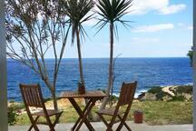Enjoy the patio near the sea.