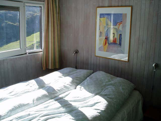 Double bed in the bedroom with a view to the mountains
