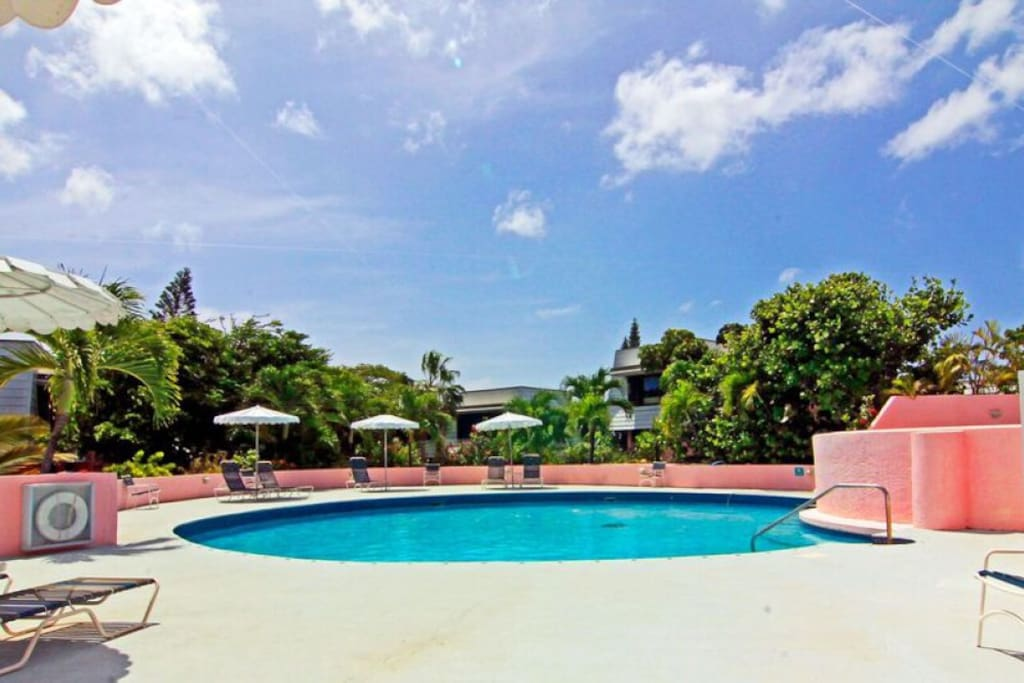 Adjacent pool, steps from condo