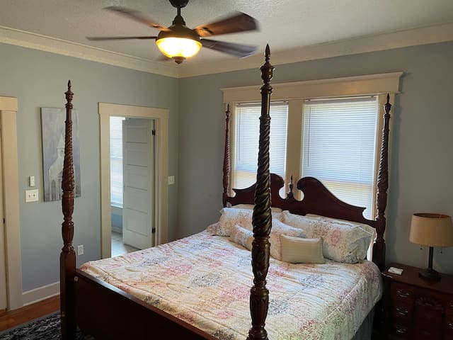 Master bedroom with en-suite bathroom and king sized bed