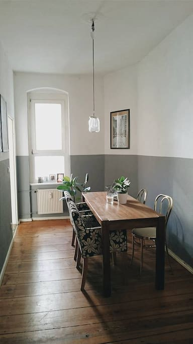 Dining room with the kitchen on the left side
