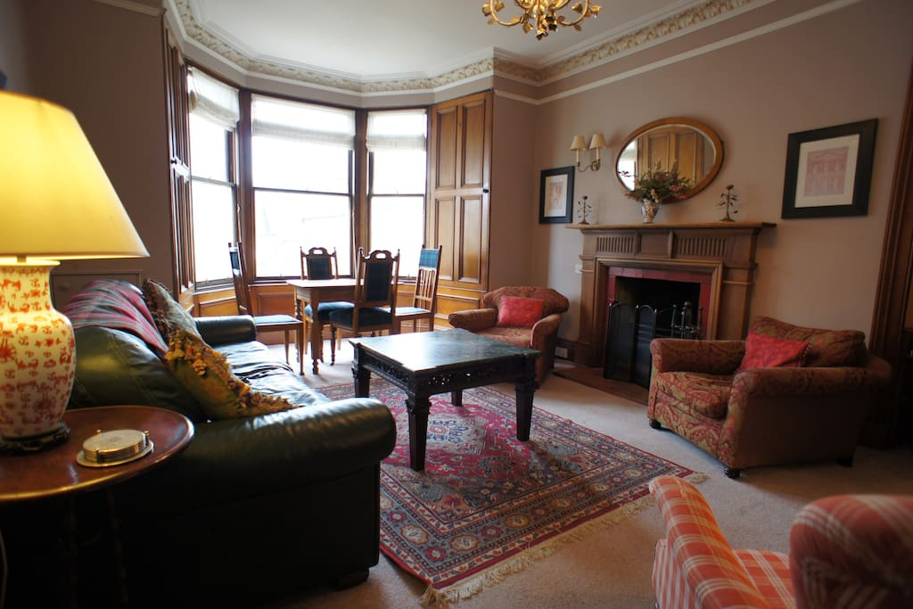 Beautifully appointed lounge with large bay window, open fire and unlimited BT wi-fi